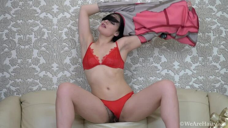 Hannah Vivienne masturbates on her leather couch