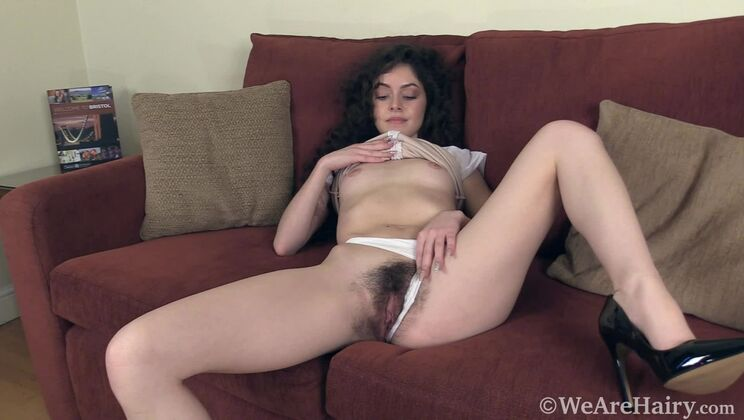 Anastasia gets naked on her red couch