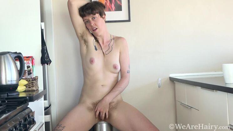 Roxanne has fun stripping naked in her kitchen