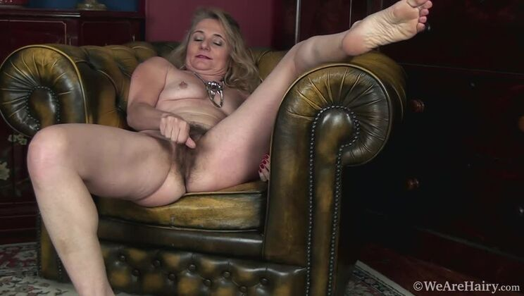 Isabella Diana strips naked on her leather chair
