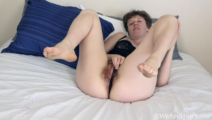 Roxanne strips naked and masturbates in bed