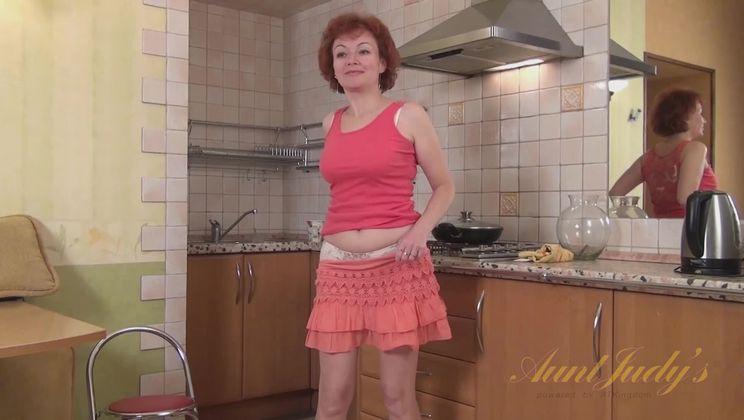 Julia masturbates in the kitchen.