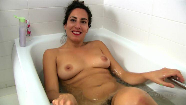 Liz bathes her hairy pussy