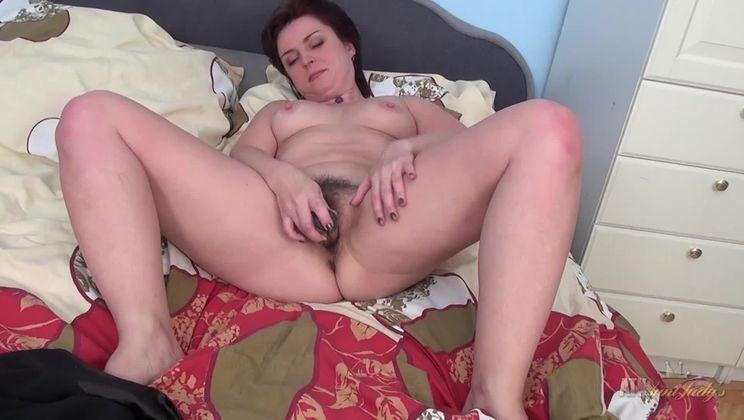 Mila masturbates and uses a toy.