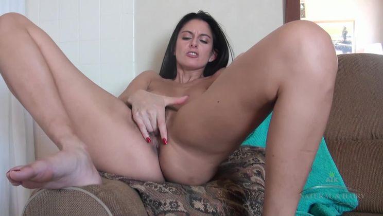Nikki Daniels fingers her sexy hairy vagina