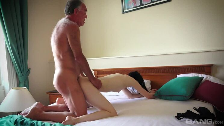 Veronika fucks a seventy year old man and watches him cum on her belly