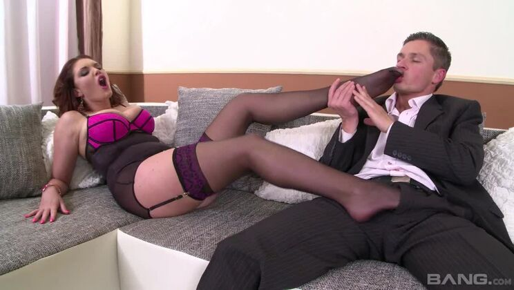 Emma Leigh jerks her stud off with her stocking covered feet