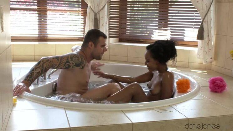 Ebony babe gives hot tub blowjob